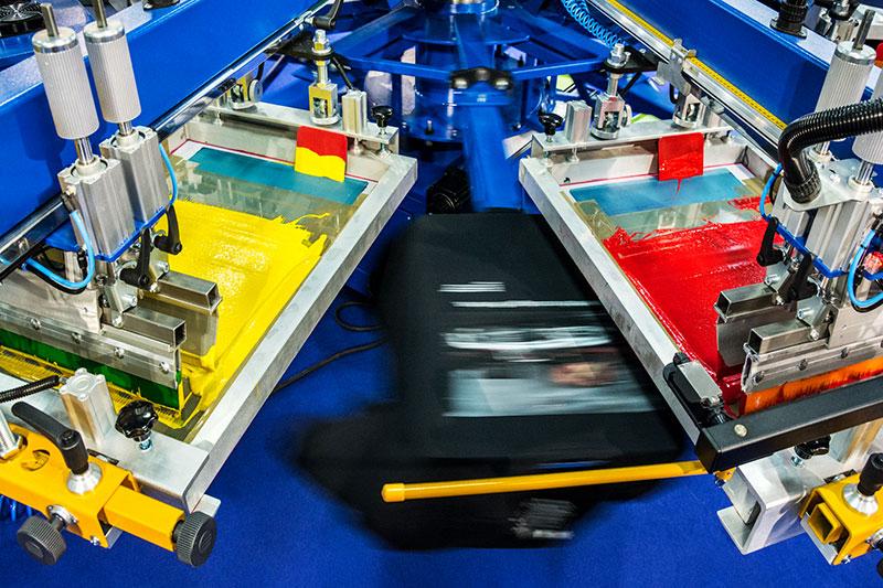 Automatic screen printing machine printing tee shirts Keith N Company