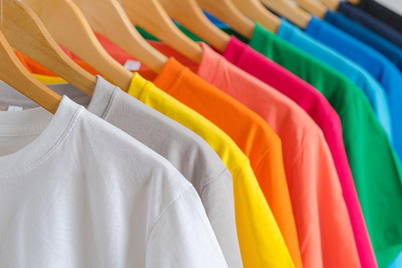 Colorful tee-shirts on hangers Keith N Company